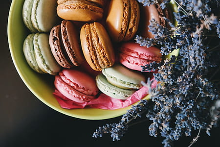 assorted-color macaroons on green bowl