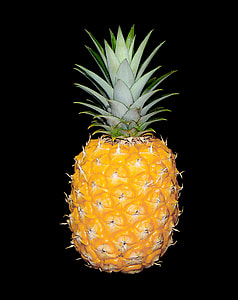 orange pineapple in black background