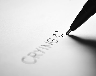 pen writing crying on the paper