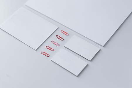 Little sheets of paper with pink paper clips