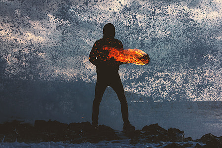 silhouette painting of man holding torch on body of water with rocks