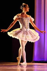 close up photo of woman wearing white ballerina dress