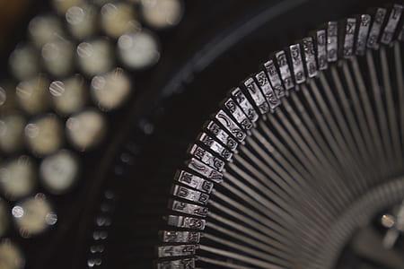 Black and Gray Typewriter in Close Up Shot