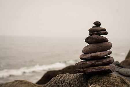 selective focus photograph of balance stone