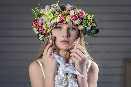 woman in green and pink petaled flower headdress