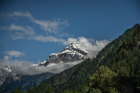 White and Green Mountain Under White Clouds
