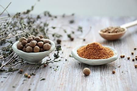 fennel seeds beside powder seasoning