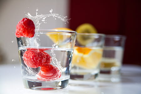 three clear rocks glasses filled with white liquids