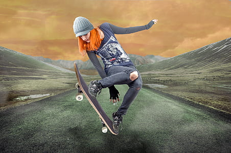 woman in blue jeans playing skateboard