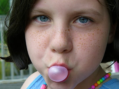 girl playing with bubblegum
