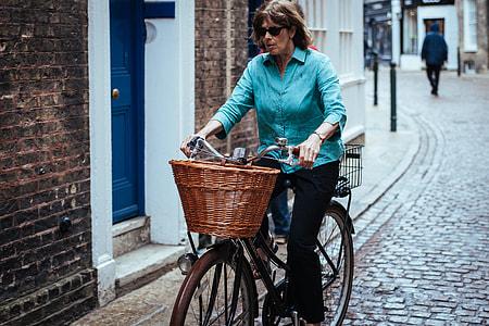 woman riding on brown city bike