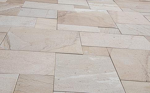 close-up photo of beige ceramic tiled floor