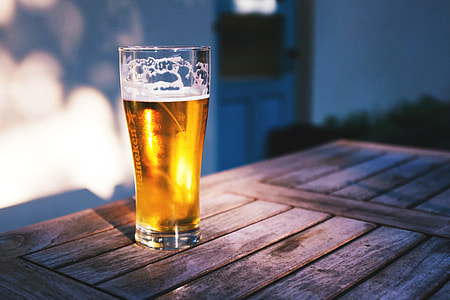 Glass of beer/lager on table