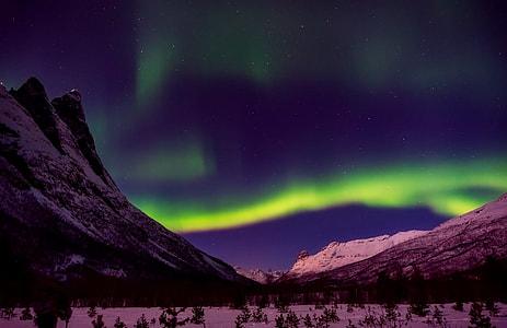 aurora borealis above mountains