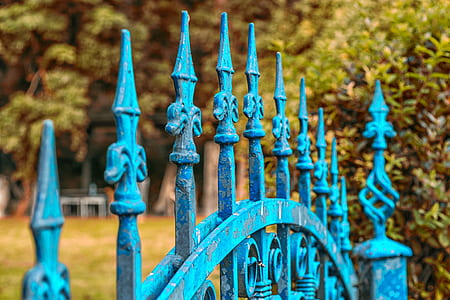 shallow focus of blue wrought iron gate