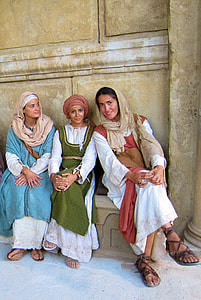 three woman wearing traditional dresses