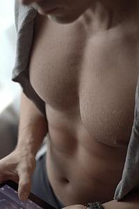 man wearing gray top