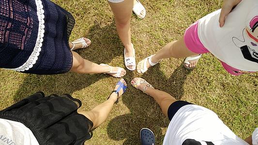 five women wearing sandals