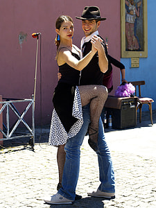 couple dancing on the street during daytime