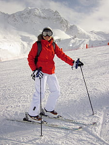 person skiing on snow during daytime