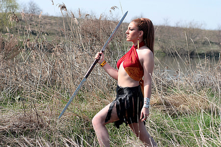 woman holding spear