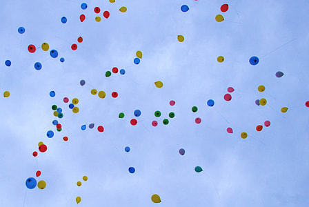 assorted-color balloon floating up in air