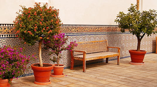 brown wooden bench in front of brown painted wall