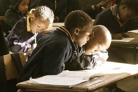 boy looking at book in school