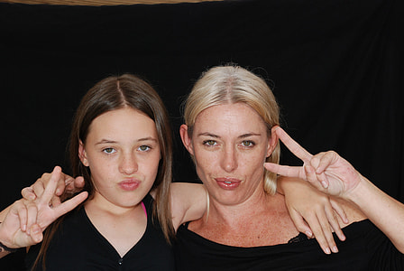two women wearing black tops