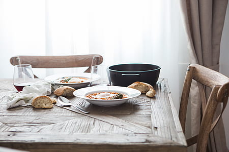 two white plates on table