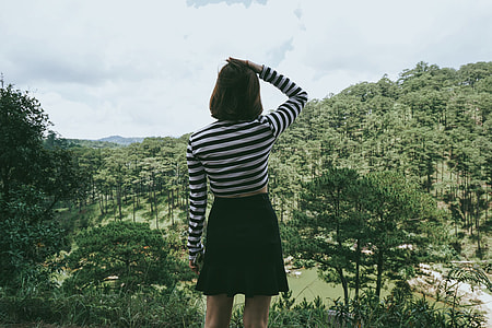 Woman standing and enjoying the scenery in Vietnam