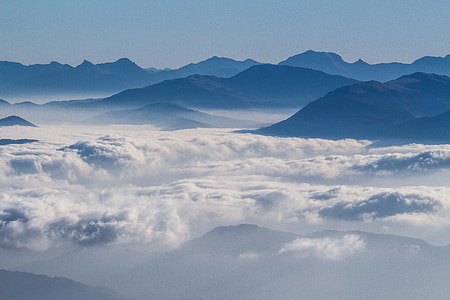 white cloud formation and mountain