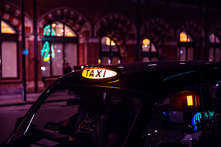A black London taxi waits for business