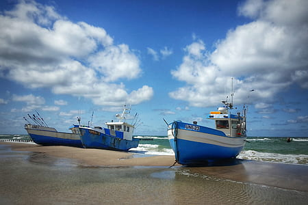 two blue ships on seashore
