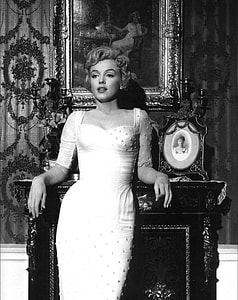 Marilyn Monroe leaning on fireplace mantel