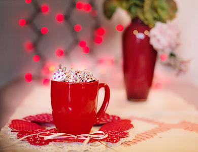 chocolate candies in red ceramic mug