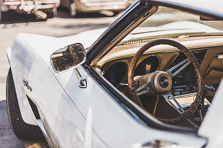 closeup photo of white classic convertible car