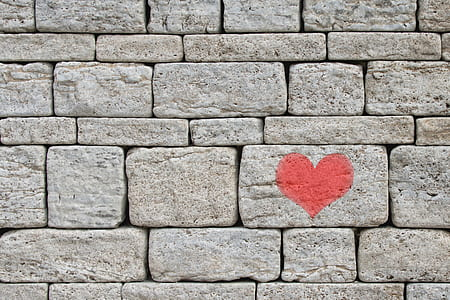 gray bricks with red heart print