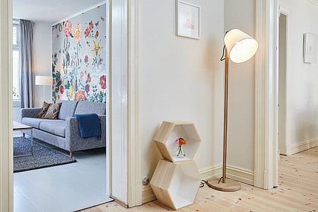 beige shade floor lamp on beige wooden parquet flooring