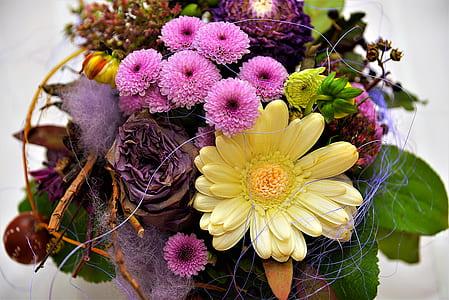 yellow daisy, pink mums centerpiece