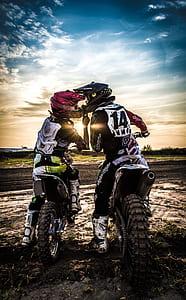 two person wearing motocross bike gear set