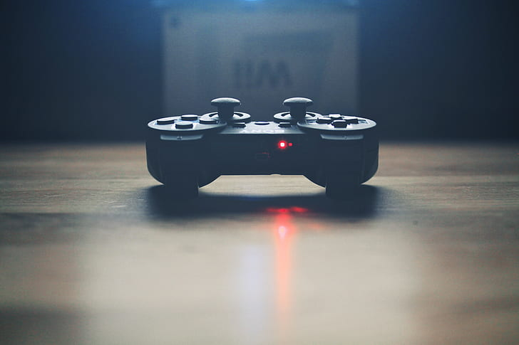 close up photograph of black game controller