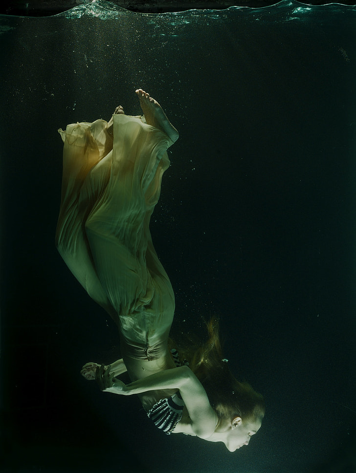 woman diving through the water