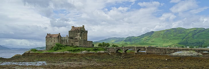photo of concrete castle near body of water