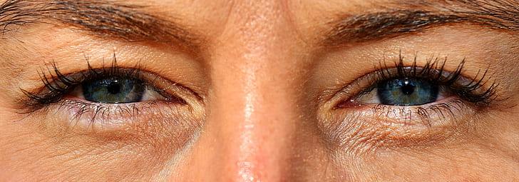 close-up portrait photo of human eyes