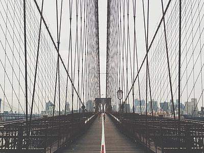 photography of  black bridge aisle