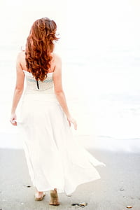 woman in white dress by the seashore photo