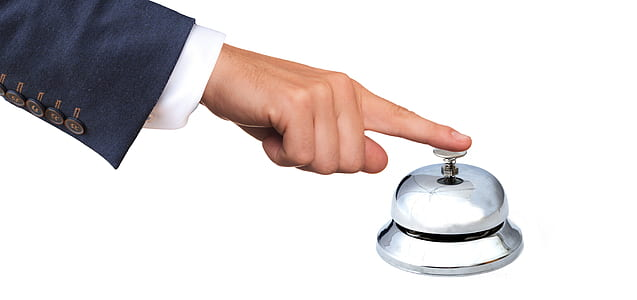 person holding ring bell