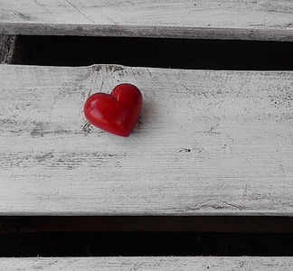 red heart decor on white wooden board
