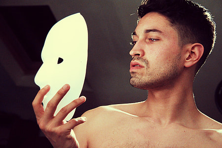 man holding white mask